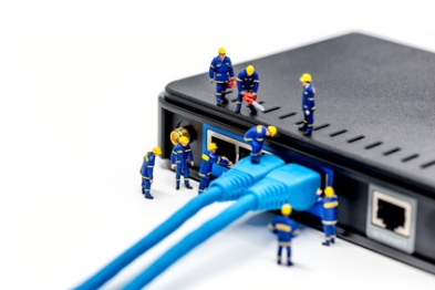 Team of technicians connecting network cable. Macro photo